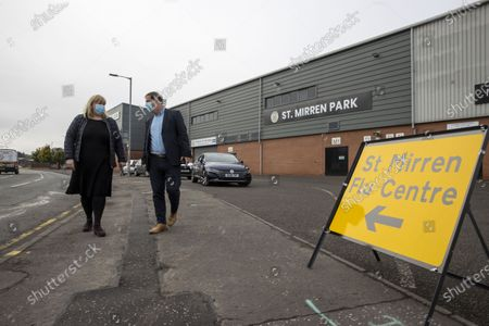 Stock Photo of St Mirren FC host local Flu Centre where you can receive your flu jab Former St Mirren player and manager Tony Fitzpatrick with Head of Service Jackie Dougall