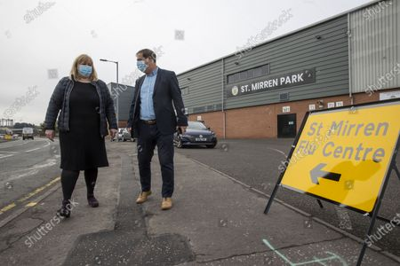 Stock Picture of St Mirren FC host local Flu Centre where you can receive your flu jab Former St Mirren player and manager Tony Fitzpatrick with Head of Service Jackie Dougall