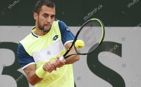 Laslo Dere of Serbia hits a backhand during his first round match against Kevin Anderson of South Africa the French Open tennis tournament at Roland Garros in Paris, France, 29 September 2020.