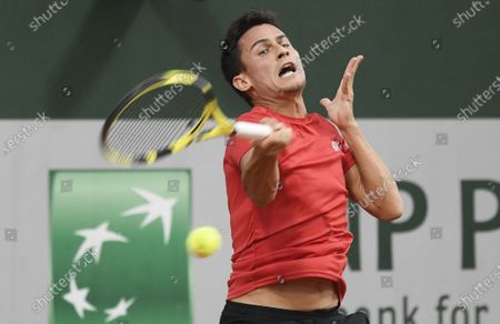 Attila Balazs of Hungary hits a forehand during his first round match against Yasutaka Uchiyama of Japan during the French Open tennis tournament at Roland Garros in Paris, France, 29 September 2020