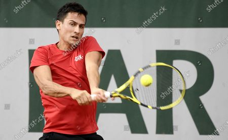 Attila Balazs of Hungary hits a backhand during his first round match against Yasutaka Uchiyama of Japan during the French Open tennis tournament at Roland Garros in Paris, France, 29 September 2020