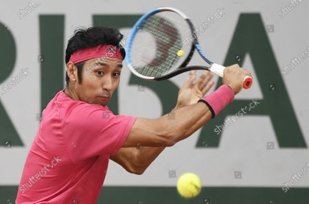 Yasutaka Uchiyama of Japan eyes the ball  during his first round match against Attila Balazs of Hungary during the French Open tennis tournament at Roland Garros in Paris, France, 29 September 2020