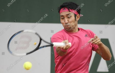 Yasutaka Uchiyama of Japan hits a forehand  during his first round match against Attila Balazs of Hungary during the French Open tennis tournament at Roland Garros in Paris, France, 29 September 2020