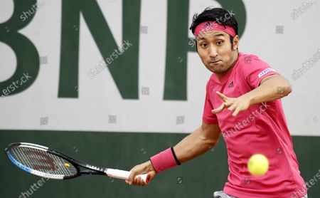 Yasutaka Uchiyama of Japan eyes the ball  during his first round match against Attila Balazs of Hungary during the French Open tennis tournament at Roland Garros in Paris, France, 29 September 2020.