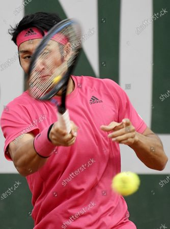 Yasutaka Uchiyama of Japan hits a forehand during his first round match against Attila Balazs of Hungary during the French Open tennis tournament at Roland Garros in Paris, France, 29 September 2020.