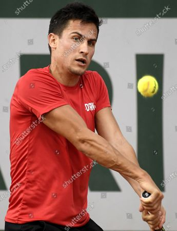 Attila Balazs of Hungary hits a backhand during his first round match against Yasutaka Uchiyama of Japan during the French Open tennis tournament at Roland Garros in Paris, France, 29 September 2020.