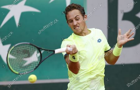 Roberto Carballes Baena of Spain hits a forehand during his first round match against Steve Johnson of the US at the French Open tennis tournament at Roland Garros in Paris, France, 29 September 2020.