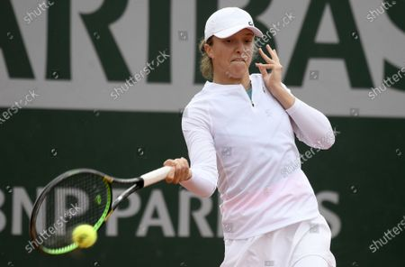 Iga Swiatek of Poland in action against Su-Wei Hsieh of Taiwan during their women's second round match during the French Open tennis tournament at Roland Garros in Paris, France, 30 September 2020.