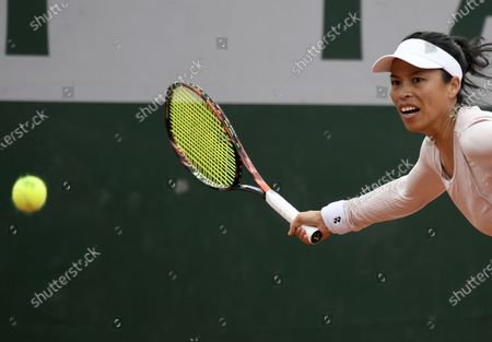 Stock Image of Su-Wei Hsieh of Taiwan in action against Iga Swiatek of Poland during their women's second round match during the French Open tennis tournament at Roland Garros in Paris, France, 30 September 2020.
