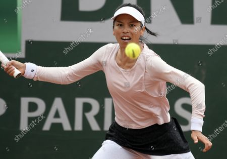 Stock Photo of Su-Wei Hsieh of Taiwan in action against Iga Swiatek of Poland during their women's second round match during the French Open tennis tournament at Roland Garros in Paris, France, 30 September 2020.