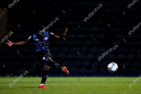 Fabio Tavares of Rochdale AFC scores his penalty
