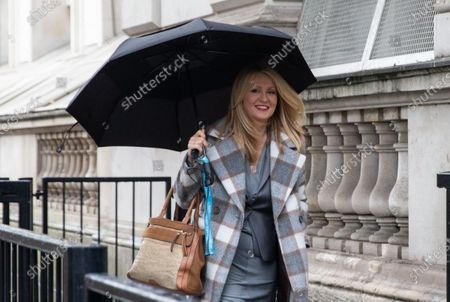 Esther McVey, MP for Tatton, arrives at the entrance to 10 Downing Street.