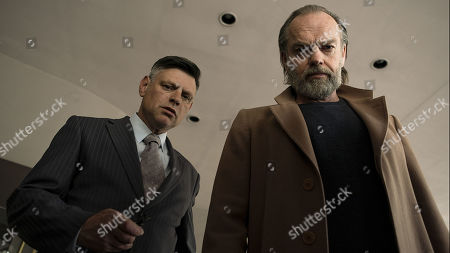 Malcolm Kennard as Sutherland and Hugo Weaving as Duke