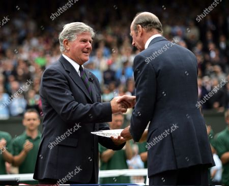 Referee Alan Mills Receives Memento Of Championships For His Long Service To Tennis Umpiring From The Duke Of Kent Andy Roddick V Roger Federer 2005 Mens Wimbledon Tennis Championship Final Roger Federer Defeated Andy Roddick 6-2 7-6 (7-2) 6-4.