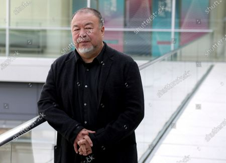 Chinese artist Ai Weiwei poses for the media during an 'I am a Hong Konger! Discussing Human Rights and Democracy' panel discussion hosted by the faction of the German Liberals at the Reichstag building, home of the German federal parliament, Bundestag, in Berlin, Germany
