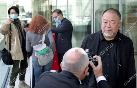 Chinese artist Ai Weiwei, right, poses for the media during an 'I am a Hong Konger! Discussing Human Rights and Democracy' panel discussion hosted by the faction of the German Liberals at the Reichstag building, home of the German federal parliament, Bundestag, in Berlin, Germany