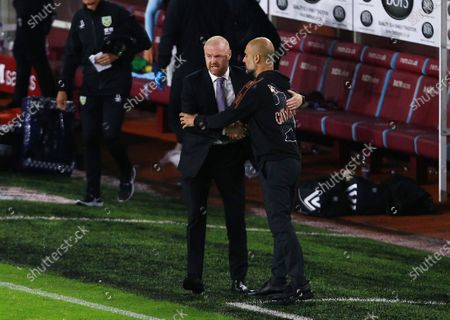 Burnley manger Sean Dyche with counterpart Pep Guardiola of Manchester City at the end of the game