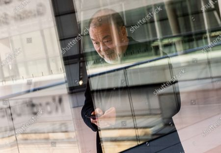 Chinese activist and artist Ai Weiwei is seen through a glass door after a panel discussion and screening of his documentary film 'Coronation,' about the lockdown in Wuhan, China during the Covid-19 outbreak, at the German parliament 'Bundestag' in Berlin, Germany, 29 September 2020. The panel discussion on the theme of human rights in Hong Kong was organized by the Cinema for Peace initiative.