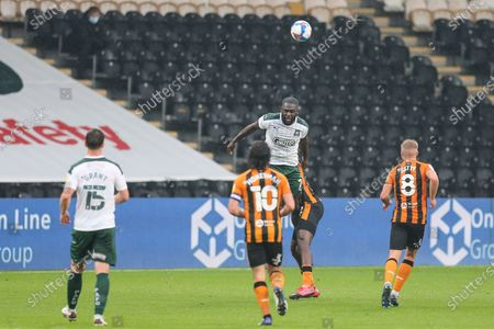 Frank Nouble (7) of Plymouth Argyle gets up high for the header