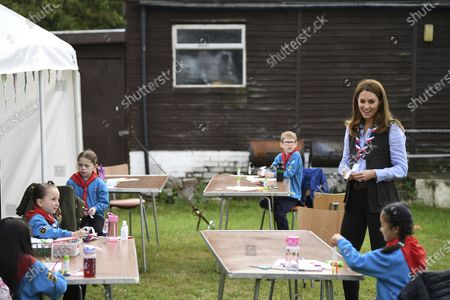 Britain's Kate, the Duchess of Cambridge joins Cubs and Beaver Scouts in outdoor activities during a visit to the 12th Northolt Scouts in West London, . The Duchess of Cambridge has become joint president of The Scout Association, alongside the Duke of Kent