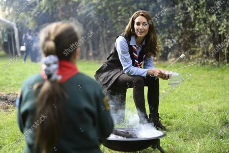 Britain's Kate, the Duchess of Cambridge toasts marshmallows with cubs during a visit to the 12th Northolt Scouts in West London, . The Duchess of Cambridge has become joint president of The Scout Association, alongside the Duke of Kent