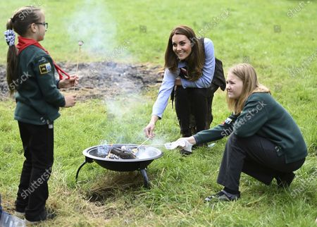 Stock Picture of Britain's Kate, the Duchess of Cambridge toasts marshmallows with cubs during a visit to the 12th Northolt Scouts in West London, . The Duchess of Cambridge has become joint president of The Scout Association, alongside the Duke of Kent