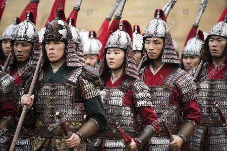 Yifei Liu as Mulan and Yoson An as Honghui