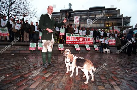 Stock Image of Pro Hunting Demonstrators Outside The House Of Commons Today Before The Vote To Ban Hunting With Dogs. Matthew Higgs With Two Puppies From The South Herts Beagles.