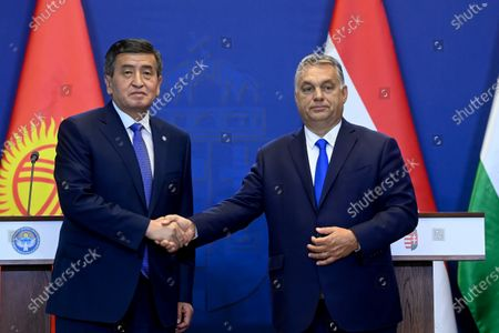 Hungarian Prime Minister Viktor Orban (R) and Kyrgyz President Sooronbay Jeenbekov (L) shake hands after signing a strategic partnership agreement between the two countries, at the Carmelite Monastery in Budapest, Hungary, 29 September 2020.
