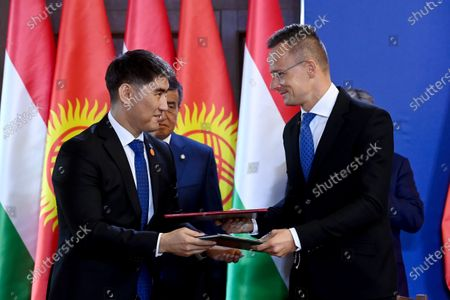 Hungarian Minister of Foreign Affairs and Trade Peter Szijjarto (R) and Kyrgyz Minister of Foreign Affairs Chingiz Aidarbekov (L) sign a bilateral agreement on the pevention of natural disasters at the Carmelite Monastery in Budapest, Hungary, 29 September 2020.