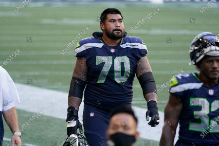 Seattle Seahawks offensive guard Mike Iupati walks off the field at halftime against the Dallas Cowboys in an NFL football game, in Seattle