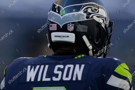 Seattle Seahawks quarterback Russell Wilson wears the name of Breonna Taylor on his helmet in support of Black Lives Matter during an NFL football game against the Dallas Cowboys, in Seattle