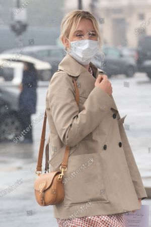 Actress Ludivine Sagnier wears a protective face mask as she arrives to attend the Dior Womenswear Spring/Summer 2021 show as part of the Paris Fashion Week, in Paris, France, 29 September 2020. The fashion week runs from 29 September to 06 October 2020.