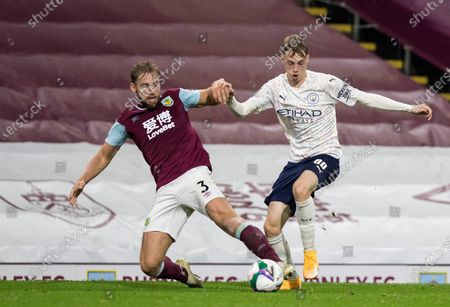 Stock Picture of Charlie Taylor of Burnley competes for the ball with Cole Palmer of Manchester City; Turf Moor, Burnley, Lancashire, England; English Football League Cup, Carabao Cup Football, Burnley versus Manchester City.