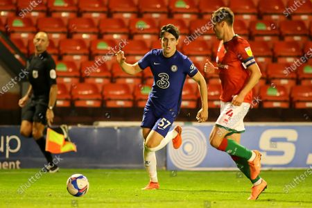 Stock Picture of Valentino Livramento of Chelsea (57) with the ball runs at Matthew Sadler of Walsall (4) during the EFL Trophy match between Walsall and U21 Chelsea at the Banks's Stadium, Walsall