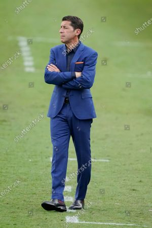 Stock Image of Houston Dynamo head coach Tab Ramos watches the action during the first half of an MLS soccer match against Nashville SC, in Nashville, Tenn