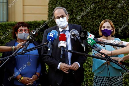 Former Catalan regional President Quim Torra (C) delivers a press conference after his meeting with former Catalonia's parliament president Carme Forcadell (R) and former Catalan regional minister Dolors Bassa (L),  day after Spanish Supreme Court upheld the ban of Torra from office for one and half year, in Barcelona, Catalonia, Spain, 29 September 2020. Torra was disqualified for ignoring the rule by Spanish Central Election Board about removing banners in support of imprisoned pro-independent leaders from public building.