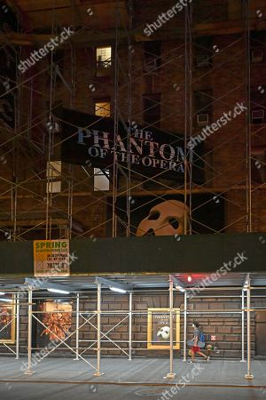 Scaffolding covers the exterior of The Majestic Theatre at 247 West 44th Street New York, NY, which remains closed and dark. Andrew Lloyd Webber's 'The Phantom of the Opera' Broadway's longest running musical, posters still adorn the theater.