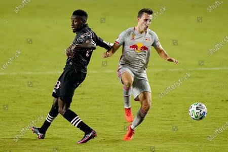 Inter Miami's Blaise Matuidi, left, and New York Red Bulls midfielder Jared Stroud go for the ball during the first half of an MLS soccer match, in Fort Lauderdale, Fla