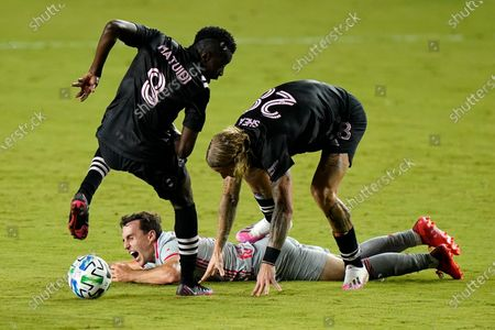 New York Red Bulls midfielder Jared Stroud falls to the pitch as Inter Miami's Blaise Matuidi (8) and Brek Shea, right, defend during the first half of an MLS soccer match, in Fort Lauderdale, Fla
