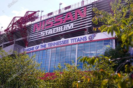 Nissan Stadium, home of the Tennessee Titans, is shown, in Nashville, Tenn. The Titans suspended in-person activities through Friday after the NFL says three Titans players and five personnel tested positive for the coronavirus, becoming the first COVID-19 outbreak of the NFL season in Week 4