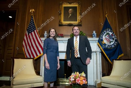 Stock Image of Amy Coney Barrett, U.S. President Donald Trump's nominee for associate justice of the U.S. Supreme Court, meets with Senator Mike Lee, a Republican from Utah, at the U.S. Capitol in Washington, D.C., U.S.,. A bruising Senate confirmation fight over Trump's Supreme Court choice may seal the fates of several incumbent senators in the November election, though it has yet to drastically alter the odds for which party will control the chamber.