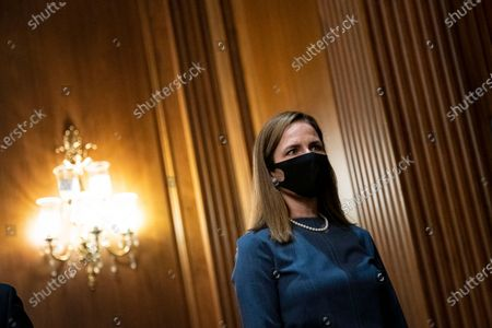 Stock Picture of Amy Coney Barrett, U.S. President Donald Trump's nominee for associate justice of the U.S. Supreme Court, arrives to meet with Senator Mike Lee, a Republican from Utah, not pictured, at the U.S. Capitol in Washington, D.C., U.S.,. A bruising Senate confirmation fight over Trump's Supreme Court choice may seal the fates of several incumbent senators in the November election, though it has yet to drastically alter the odds for which party will control the chamber.
