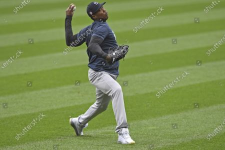Stock Photo of New York Yankees pitcher Aroldis Chapman throws in the outfield before Game 1 of an American League wild-card baseball series against the Cleveland Indians, in Cleveland
