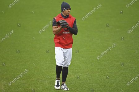 Cleveland Indians' Cesar Hernandez warms up before Game 1 of an American League wild-card baseball series against the New York Yankees, in Cleveland