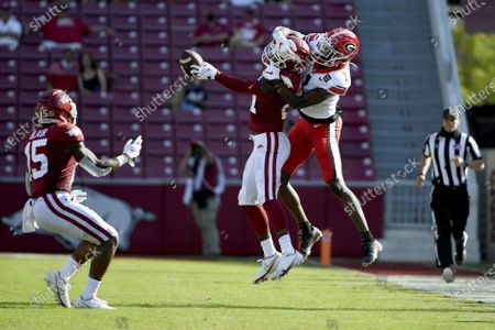 Arkansas defensive back Montaric Brown (21) breaks up a pass intended for Georgia receiver George Pickens (1) during an NCAA college football game in Fayetteville, Ark