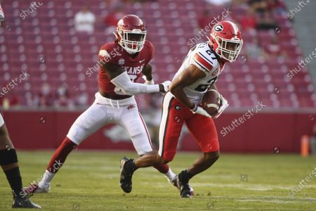 Georgia defensive back Eric Stokes (27) intercepts a pass intended for Arkansas Mike Woods (8) during the second half of an NCAA college football game in Fayetteville, Ark