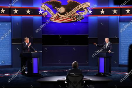 US President Donald J. Trump (L) and Democratic presidential candidate Joe Biden (R) participate with Moderator Chris Wallace (C) in the first 2020 presidential election debate at Samson Pavilion in Cleveland, Ohio, USA, 29 September 2020. The first presidential debate is co-hosted by Case Western Reserve University and the Cleveland Clinic.