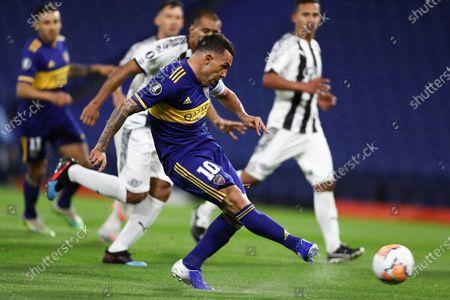 Carlos Tevez of Argentina's Boca Juniors controls the ball during a Copa Libertadores soccer match against Paraguay's Libertad in Buenos Aires, Argentina