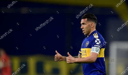 Carlos Tevez of Argentina's Boca Juniors stand on the field during a Copa Libertadores soccer match against Paraguay's Libertad in Buenos Aires, Argentina